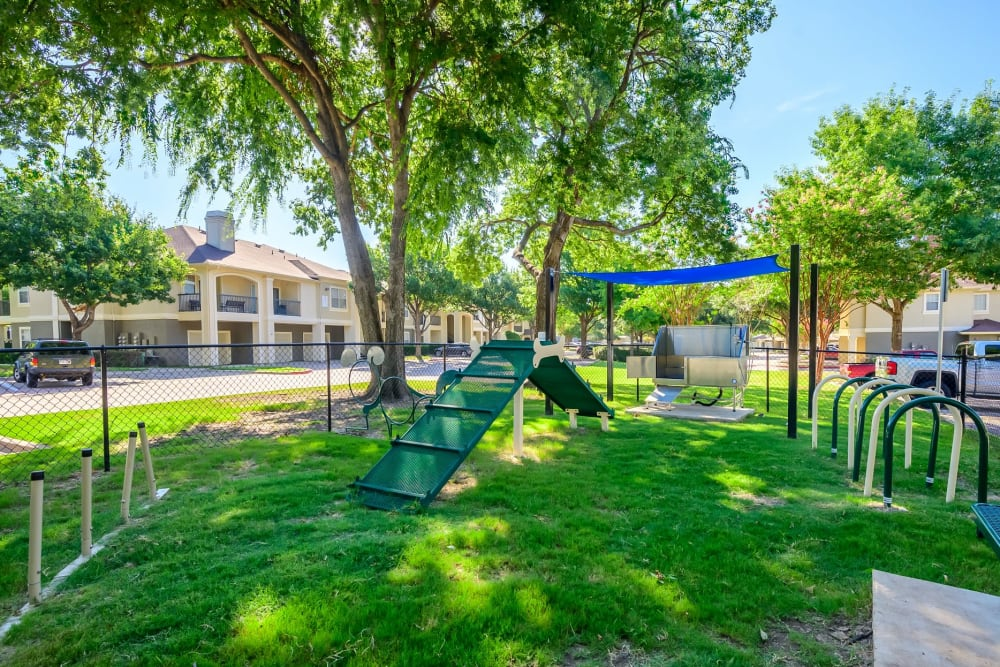 Bark park with an agility course onsite at 23Hundred @ Ridgeview in Plano, Texas