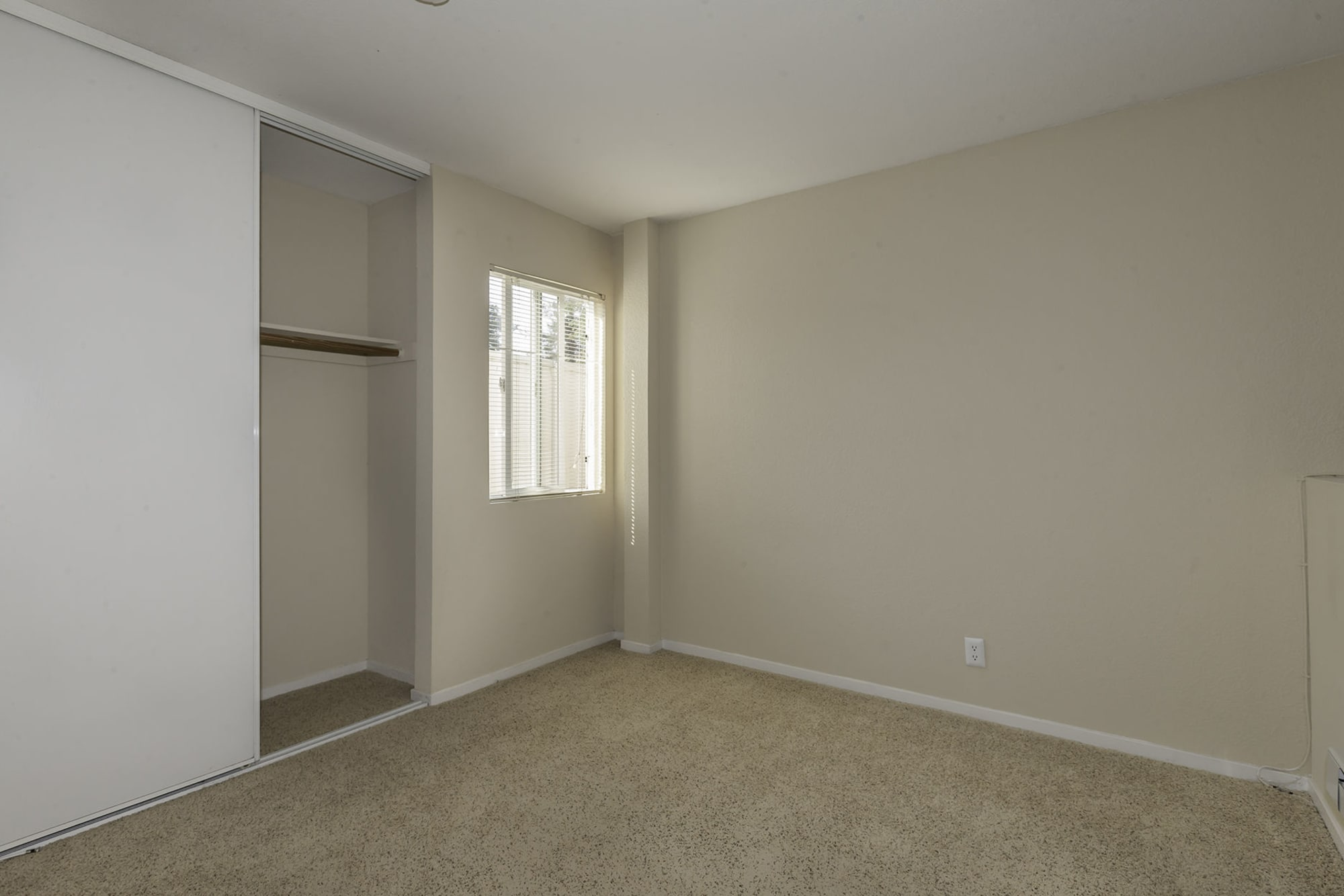 The Timbers Apartments offers a bedroom with closet in Hayward, CA