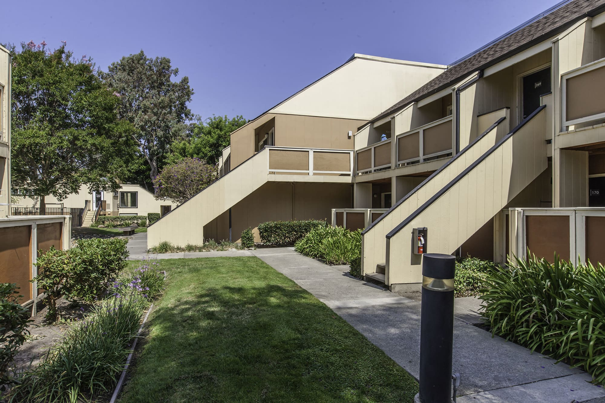 Apartments with walking paths atThe Timbers Apartments in Hayward, CA