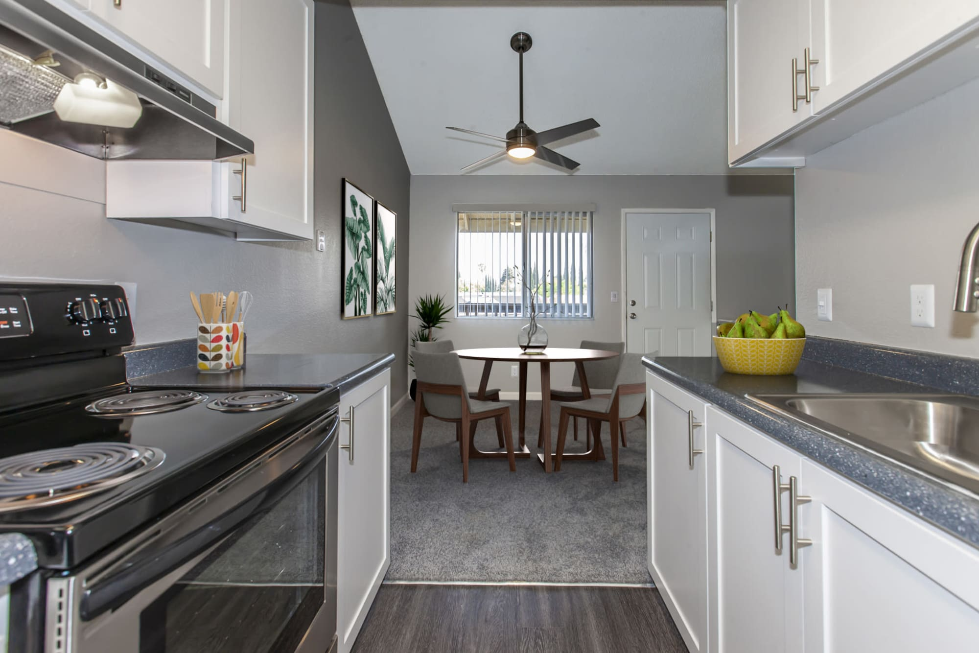A renovated kitchen with white cabinets at Avery Park Apartments in Fairfield, California
