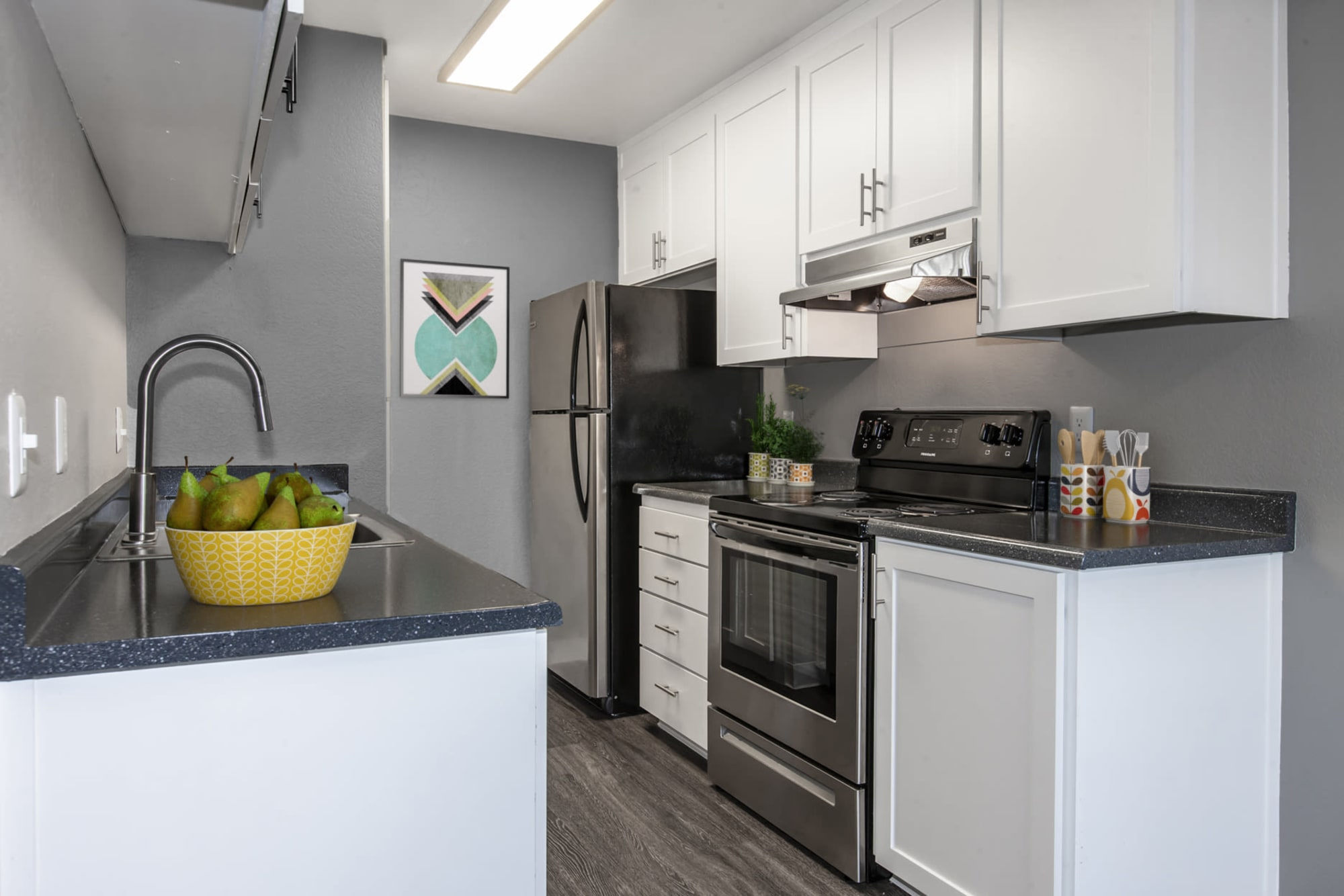 Stylish gray and white kitchen at Avery Park Apartments in Fairfield, California