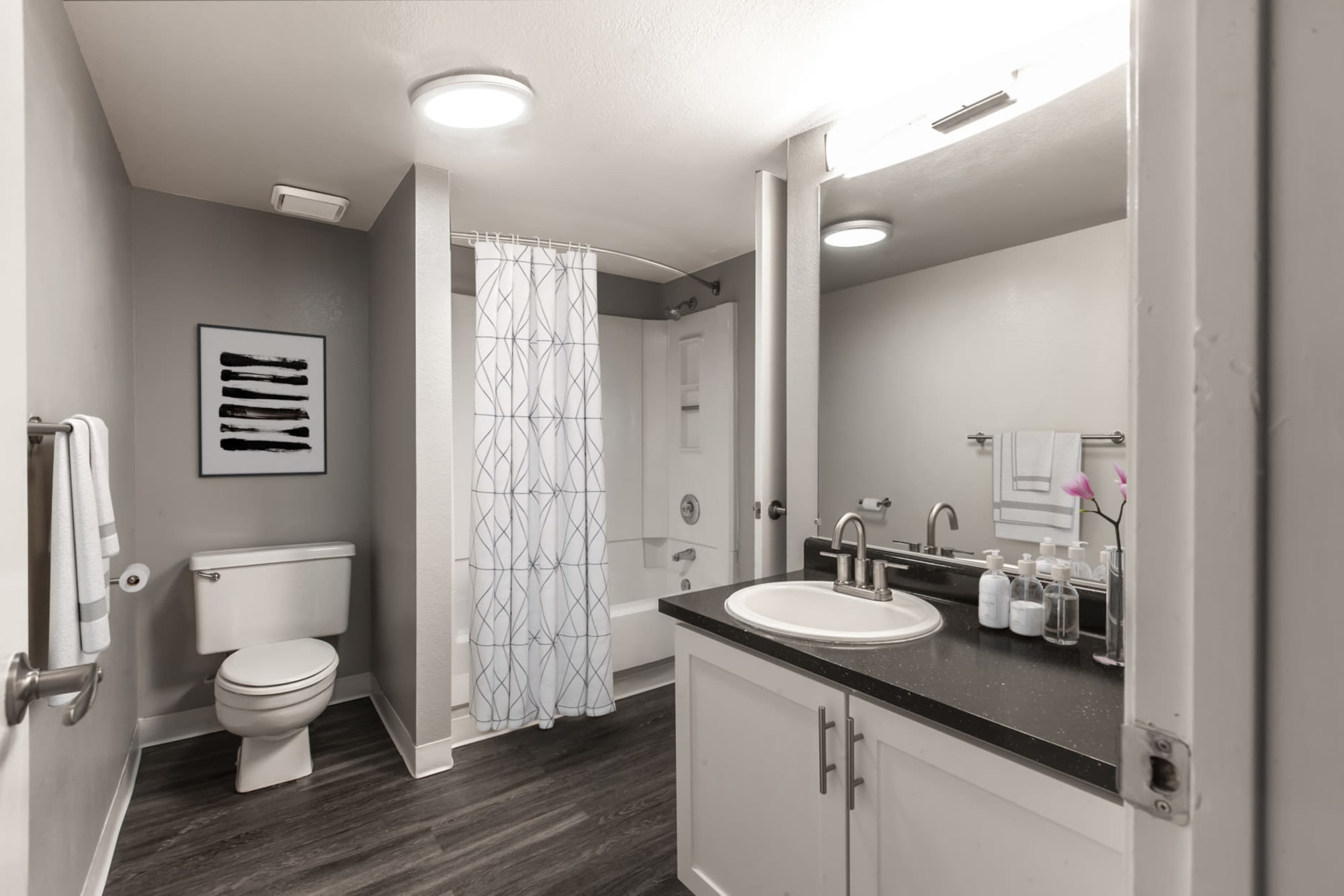 Roomy bathroom with a tub and shower at Bennington Apartments in Fairfield, California