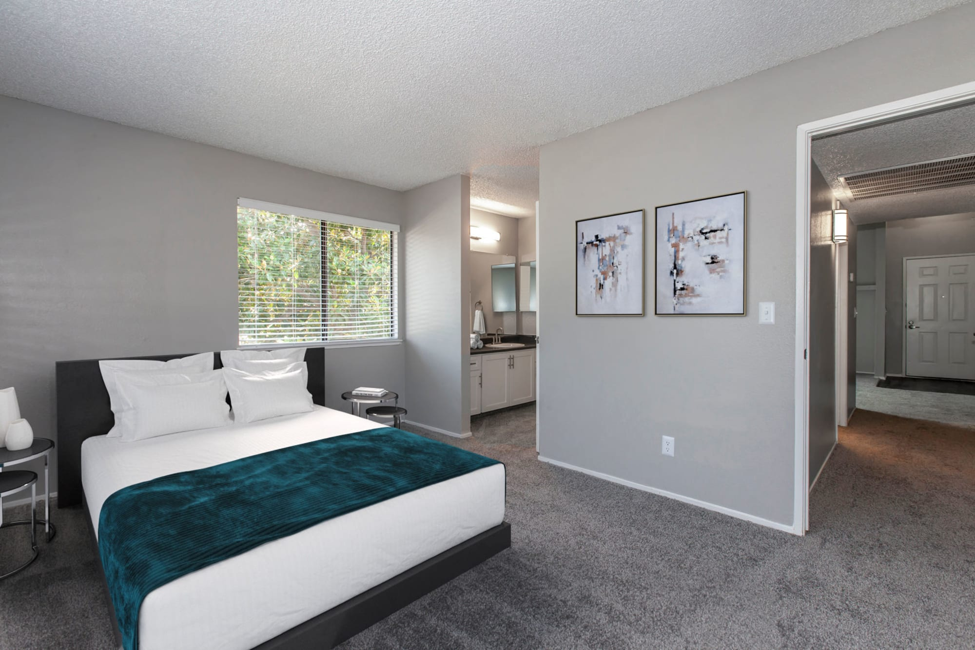 Spacious master bedroom with attached bathroom at Bennington Apartments in Fairfield, California