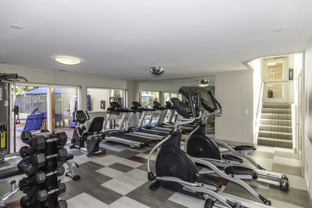 Clean, modern community gym at The Timbers Apartments in Hayward, California