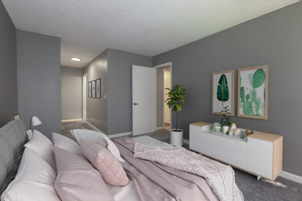 Spacious master bedroom with gray walls at Avery Park Apartments in Fairfield, California