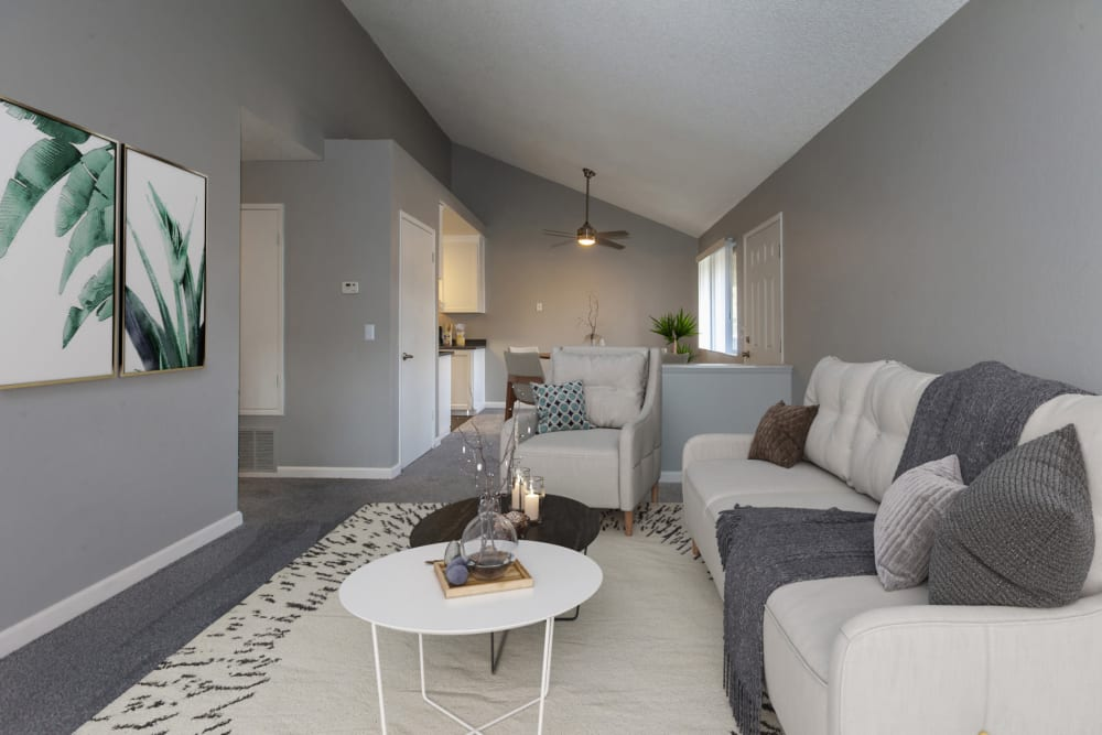 Spacious, newly renovated living room with plush carpeting at Avery Park Apartments in Fairfield, California