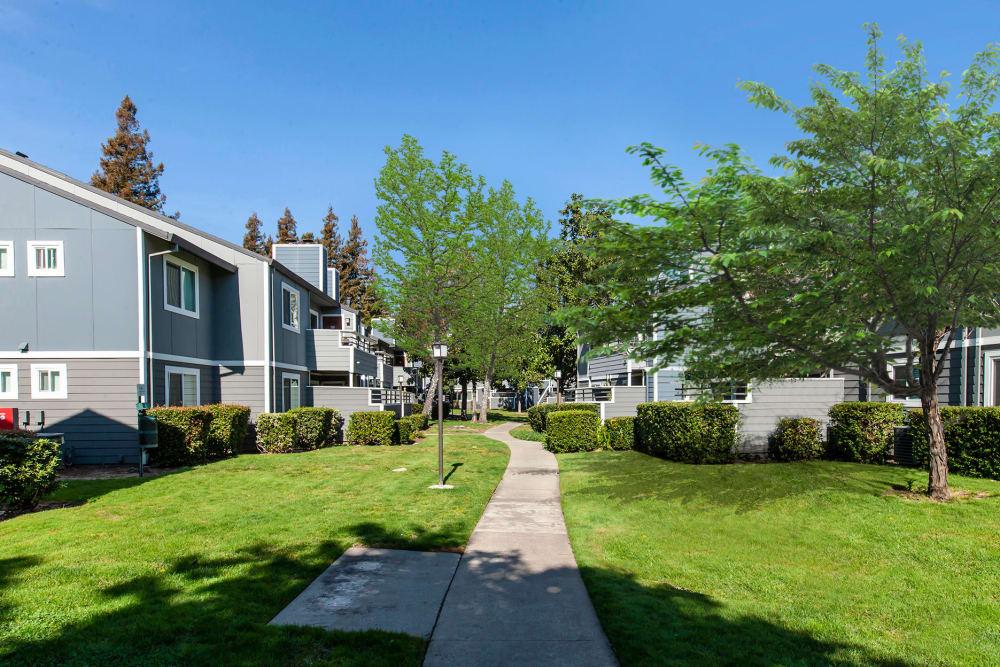 A walkway through the community at Bennington Apartments in Fairfield, California
