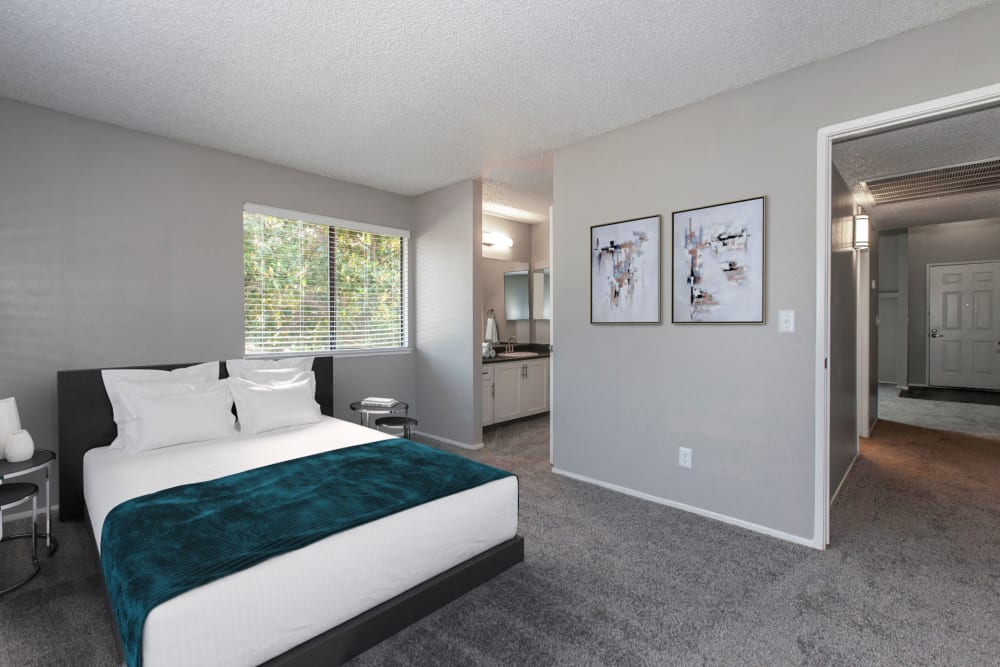 A comfortable and stylish bedroom at Bennington Apartments in Fairfield, California