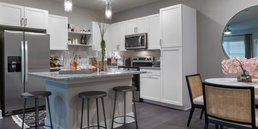 Large kitchen with white cabinets and stainless steel appliances at Reunion at 400 in Kissimmee, Florida