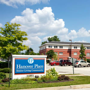 Driveway and signage outside of Hanover Place in Tinley Park, Illinois