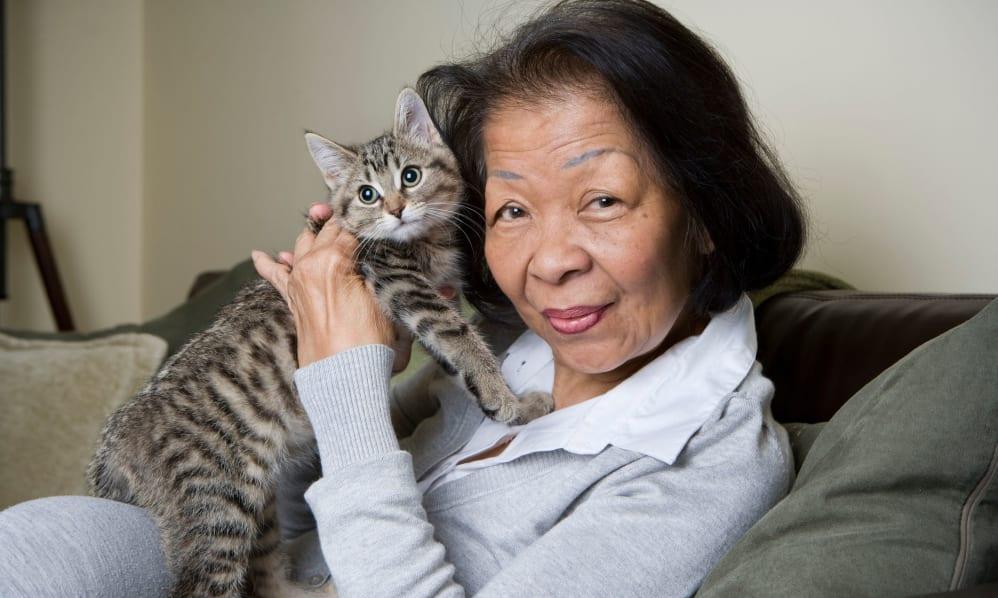 A photo of a woman holding a cat at Brookdale Cedar Ridge.