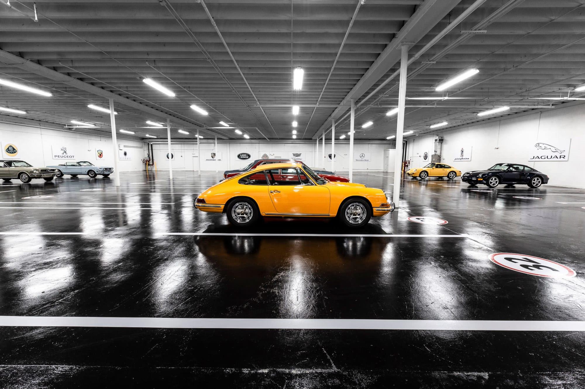 The profile of a yellow Porsche sports car, stored at Premier Car Storage in Miami, Florida/