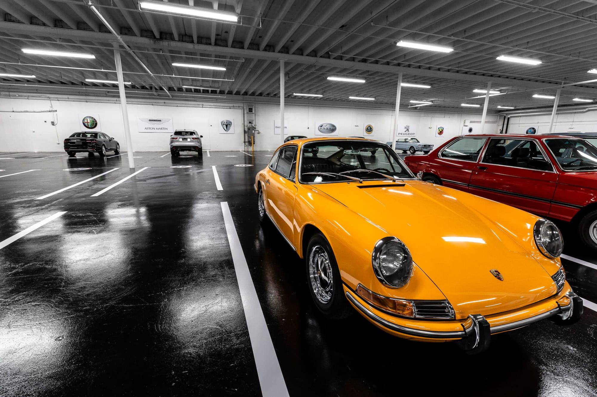 An alternate view of a Porsche sports car at Premier Car Storage in Miami, Florida