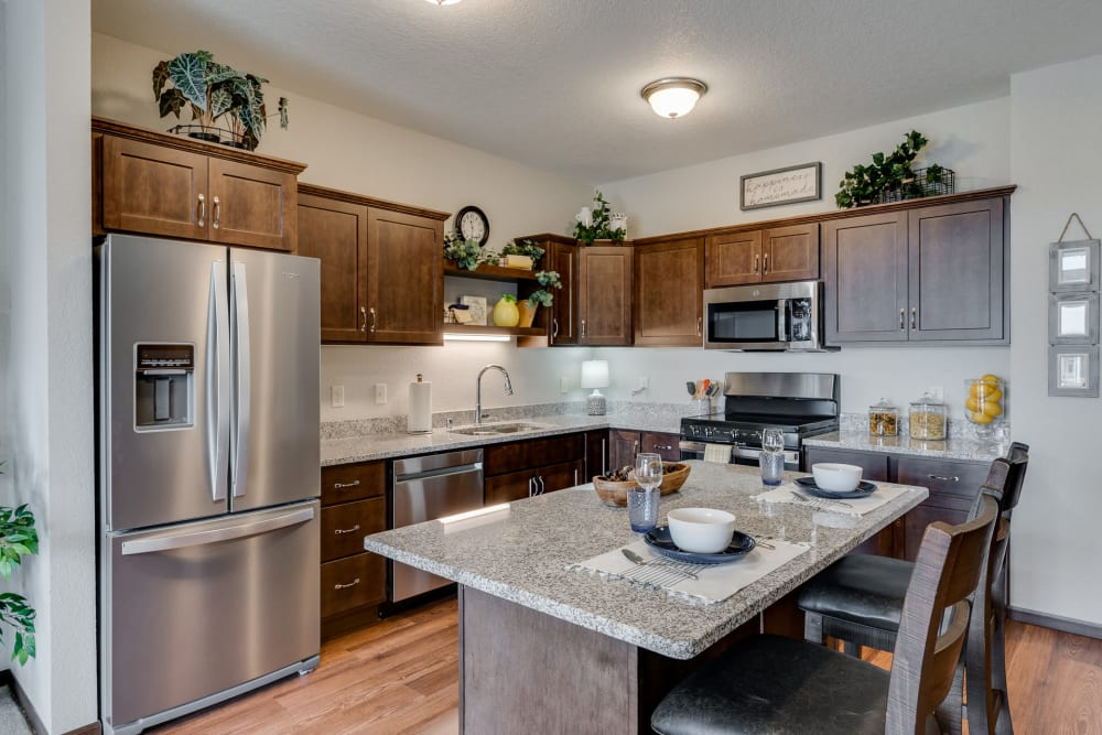Kitchen with island seating at The Fields at Arbor Glen in Lake Elmo, Minnesota