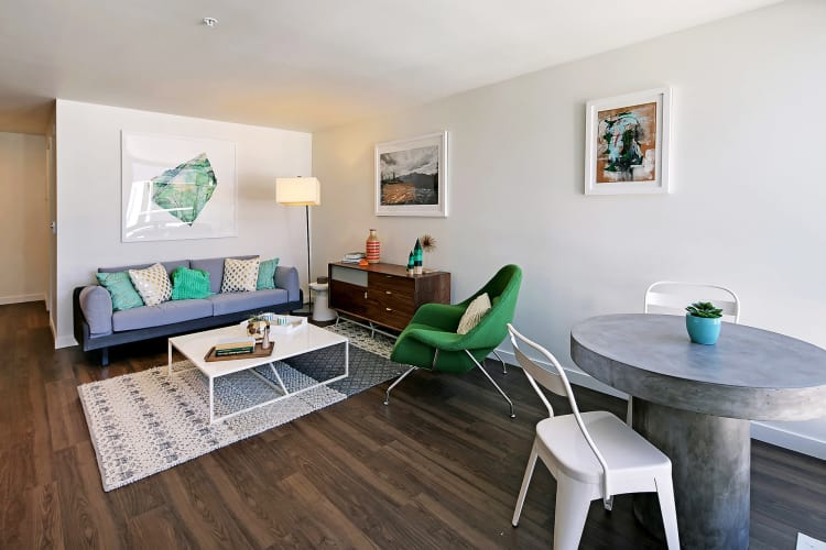 Rooster Apartments offers a beautiful living room in Seattle, Washington