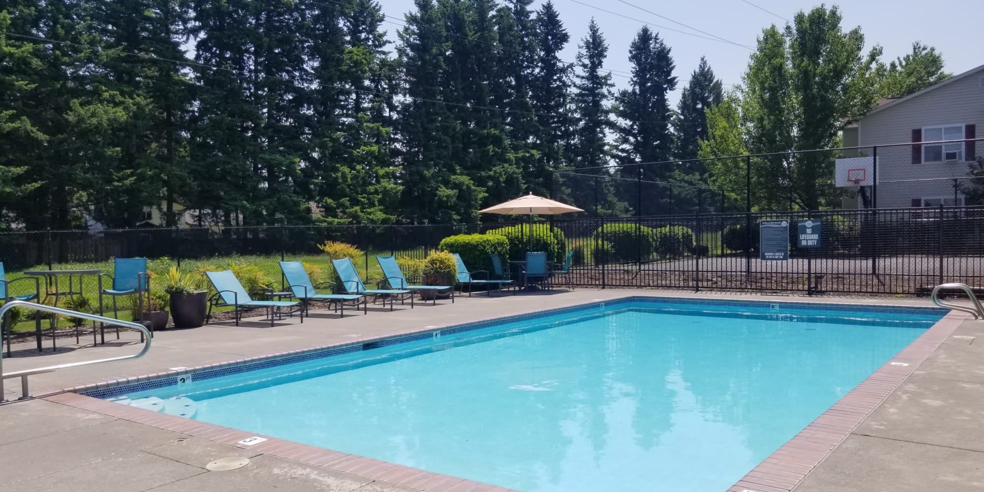 beautiful pool view with lounge chairs in Gresham, OR