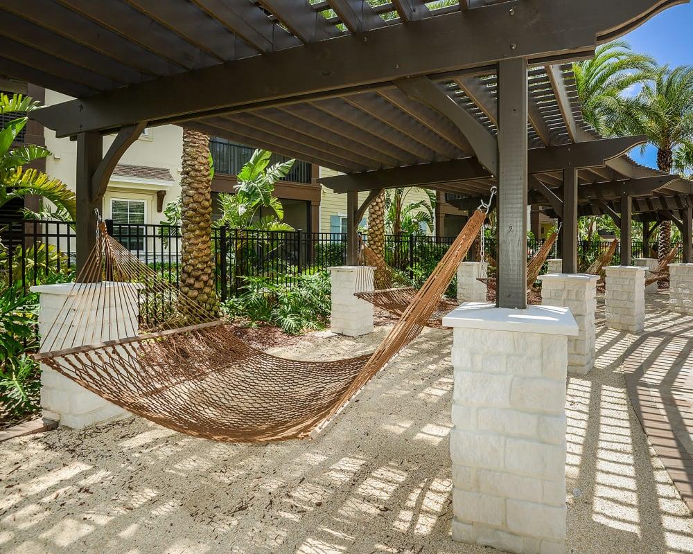 Hammock hung between posts under a pergola at Cabana Club and Galleria Club in Jacksonville, Florida