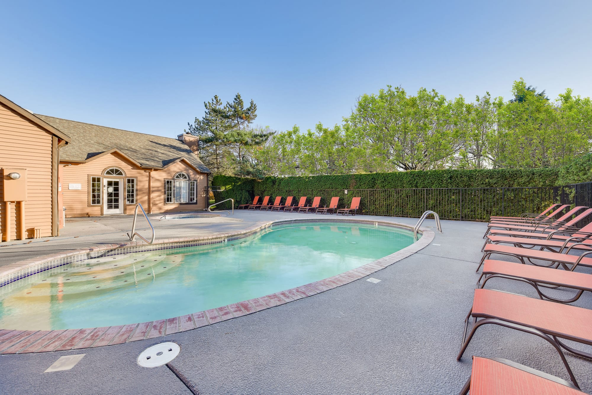Sparkling pool with lounge chairs at Renaissance at 29th Apartments in Vancouver, Washington