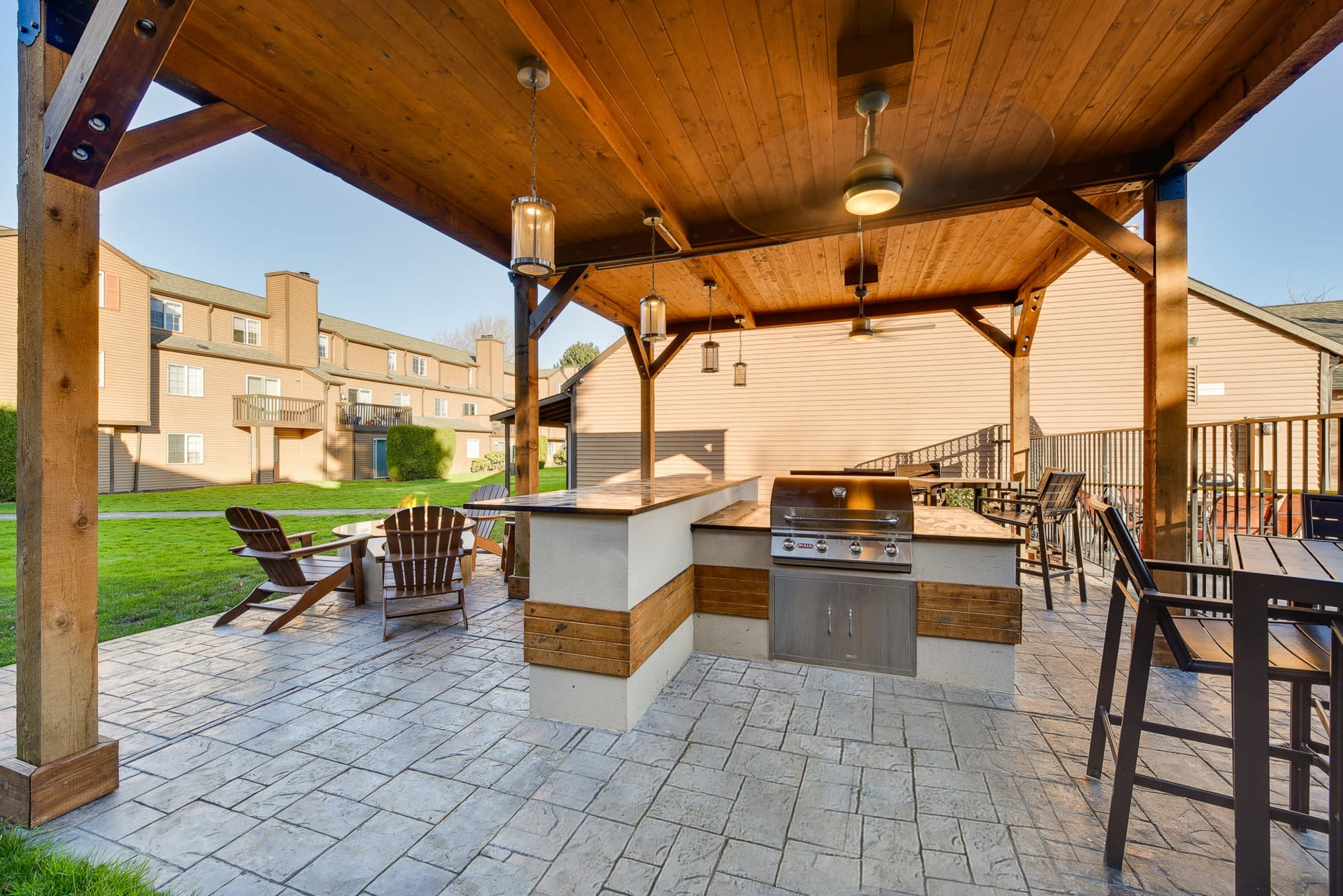 Covered BBQ and fire pit area at Renaissance at 29th Apartments in Vancouver, Washington