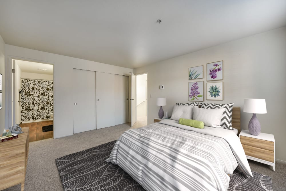 Decorated master bedroom with a large closet at Renaissance at 29th Apartments in Vancouver, Washington