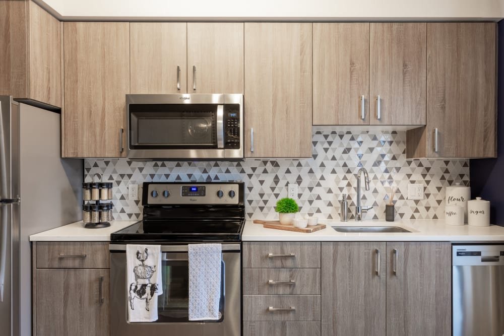 Stainless-steel appliances in a model apartment's kitchen at ArLo Apartments in Portland, Oregon