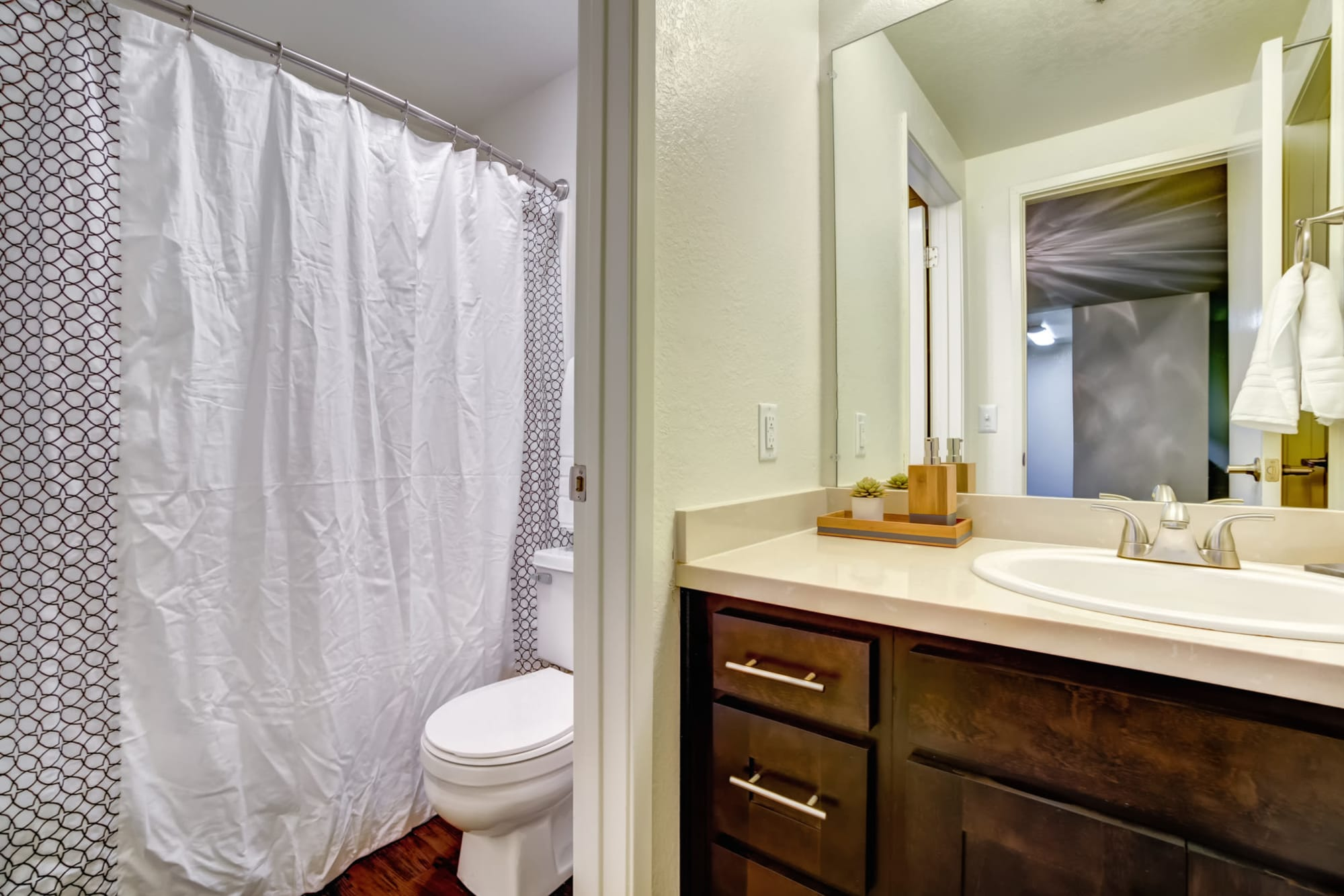 Brown Renovated Bathroom with tub at Serramonte Ridge Apartment Homes