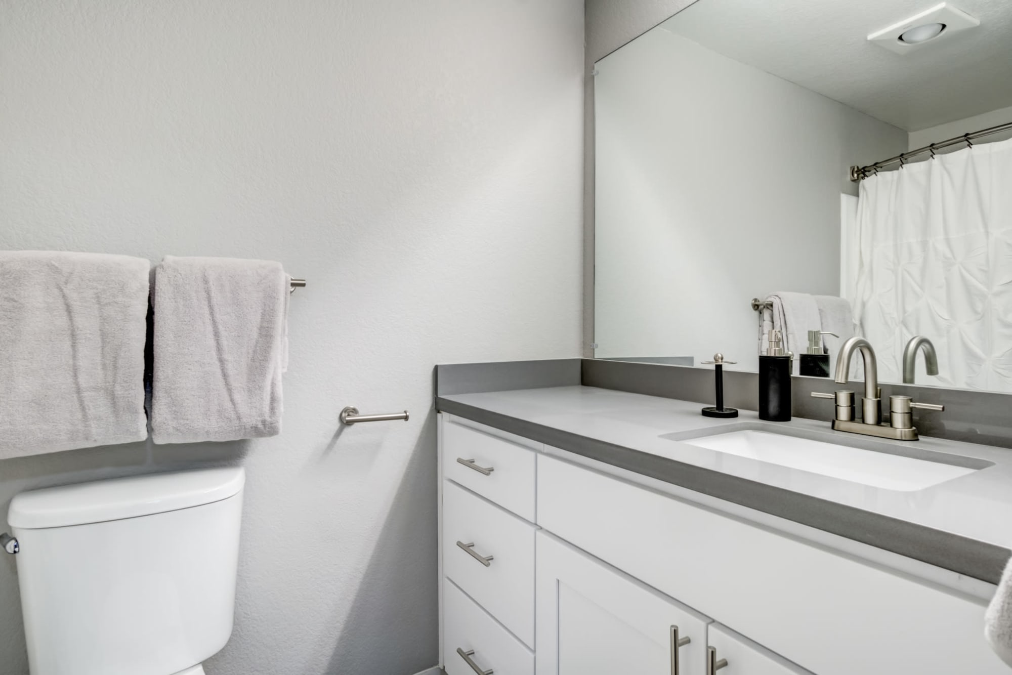 An restroom with modern style at Serramonte Ridge Apartment Homes in Daly City, California