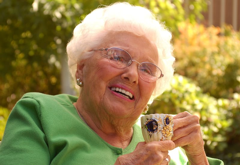 Woman with a teacup at Carefield Living.