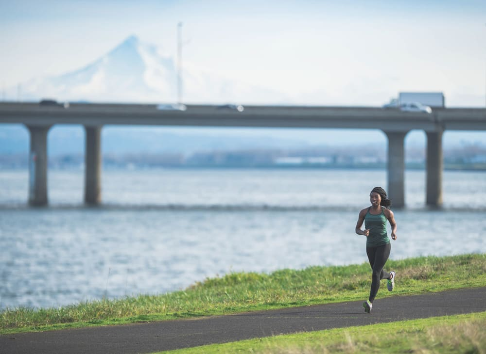 A women on a jog along the waterfront near The Columbia at the Waterfront in Vancouver, Washington