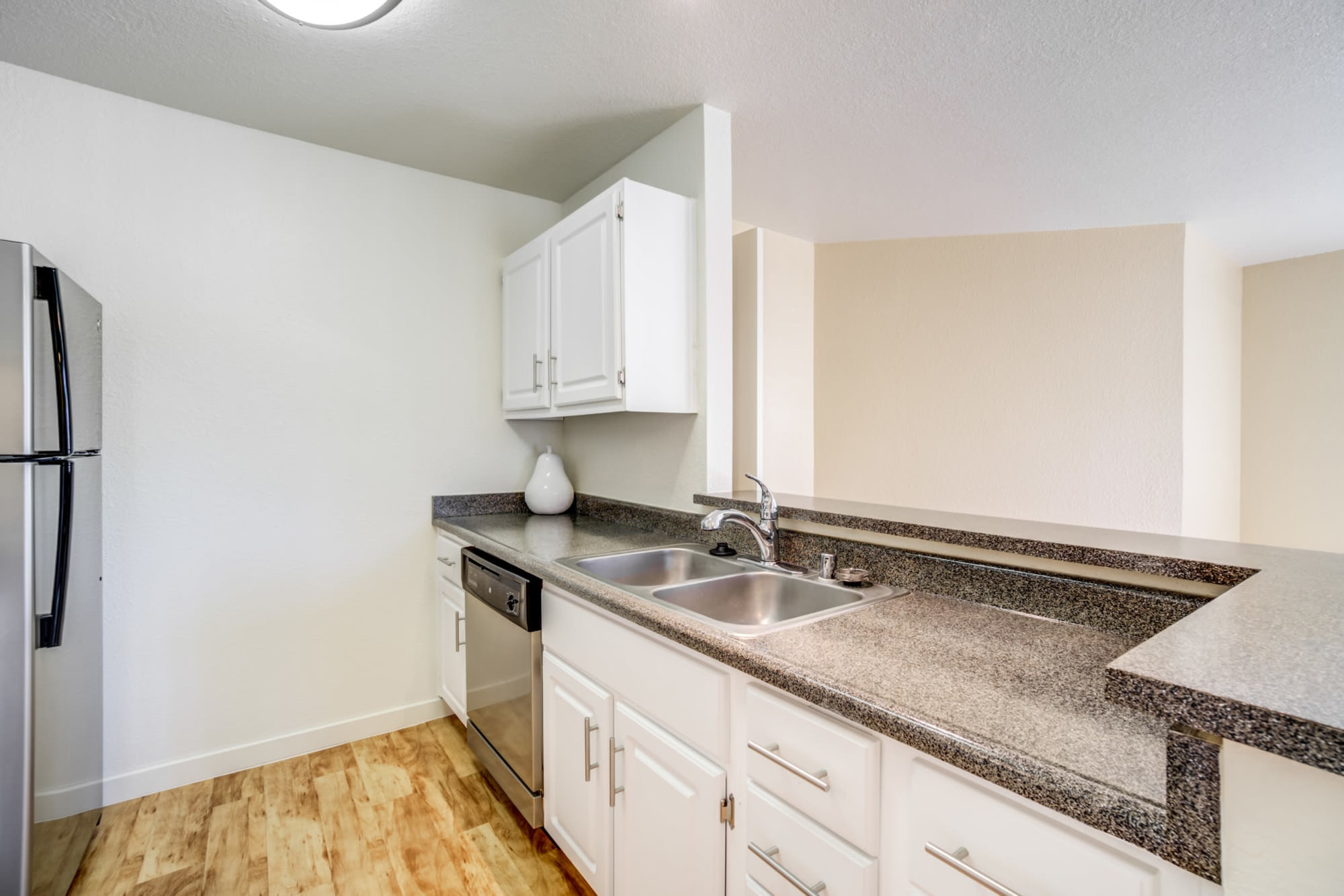 Fully Equipped Kitchen with Stainless steel appliances and bar top at Sommerset Apartments in Vacaville, CA