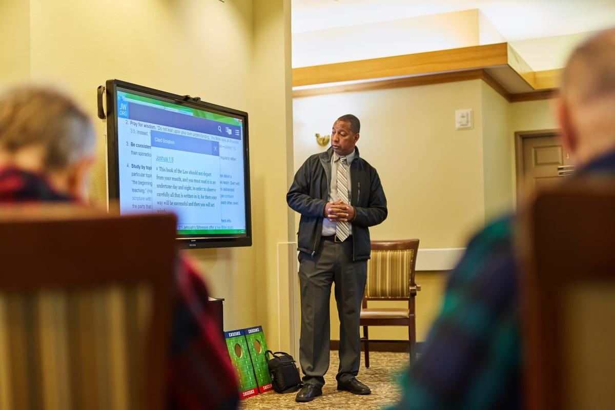Residents listening to a presentation at Farmington Square Tualatin in Tualatin, Oregon