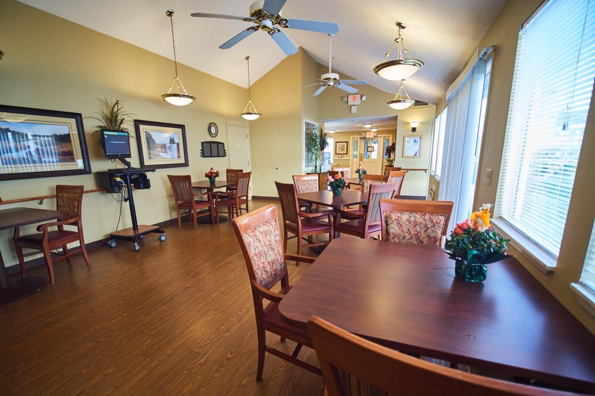 Dining room with hardwood floors at Farmington Square Beaverton in Beaverton, Oregon