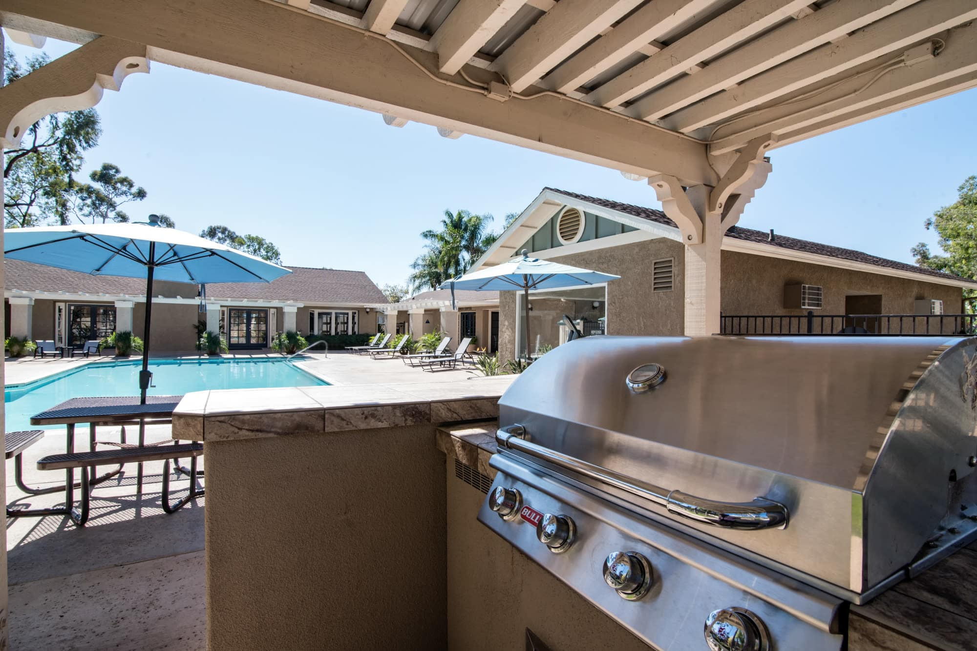 Covered poolside barbecue area at Lakeview Village Apartments in Spring Valley, California