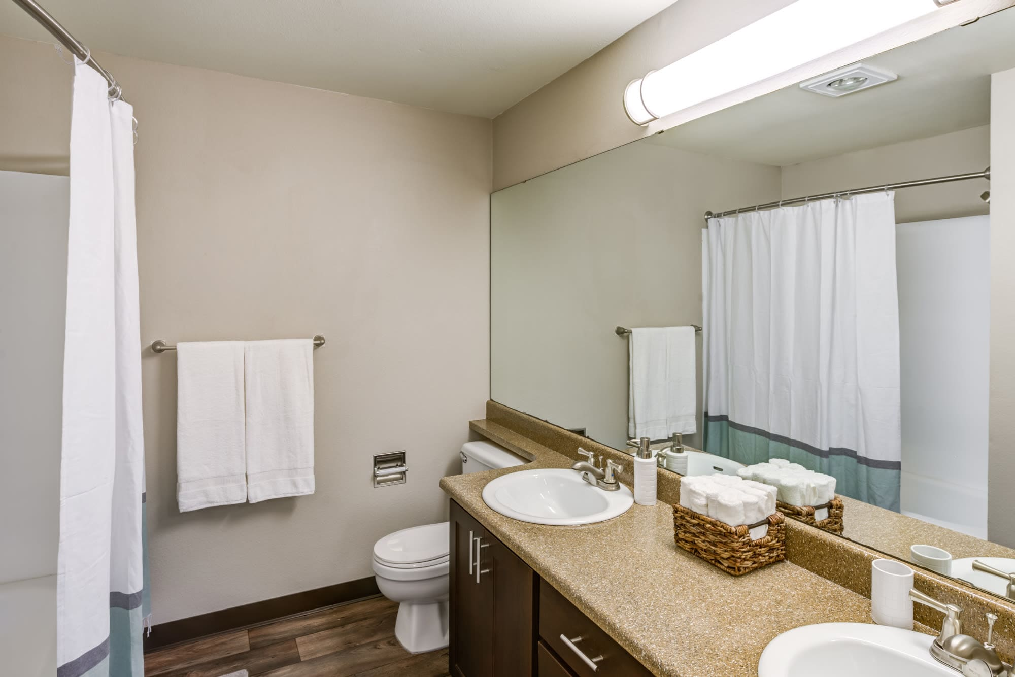 Bathroom with tub at Olin Fields Apartments