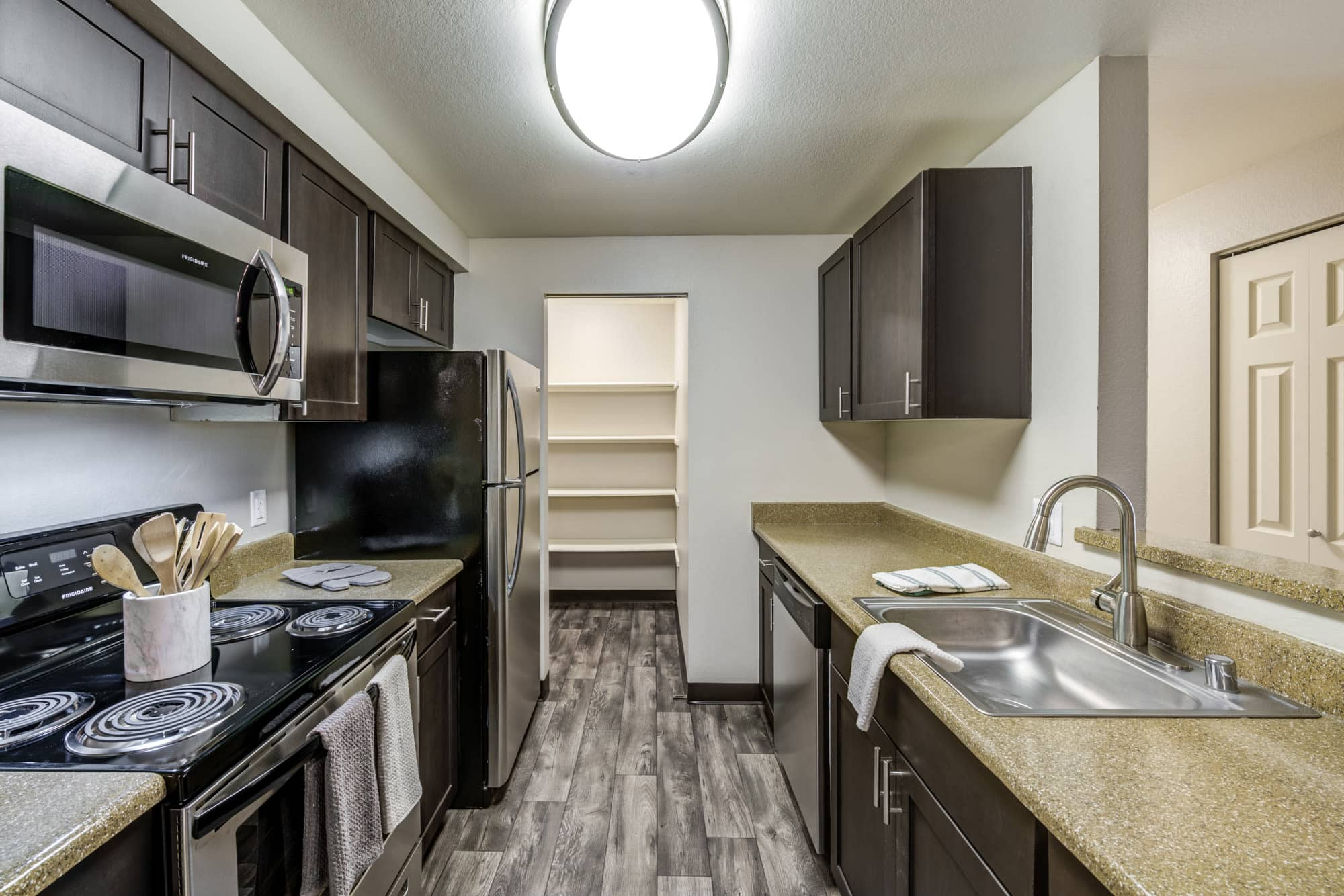 brown renovated model Kitchen at Olin Fields Apartments in Everett