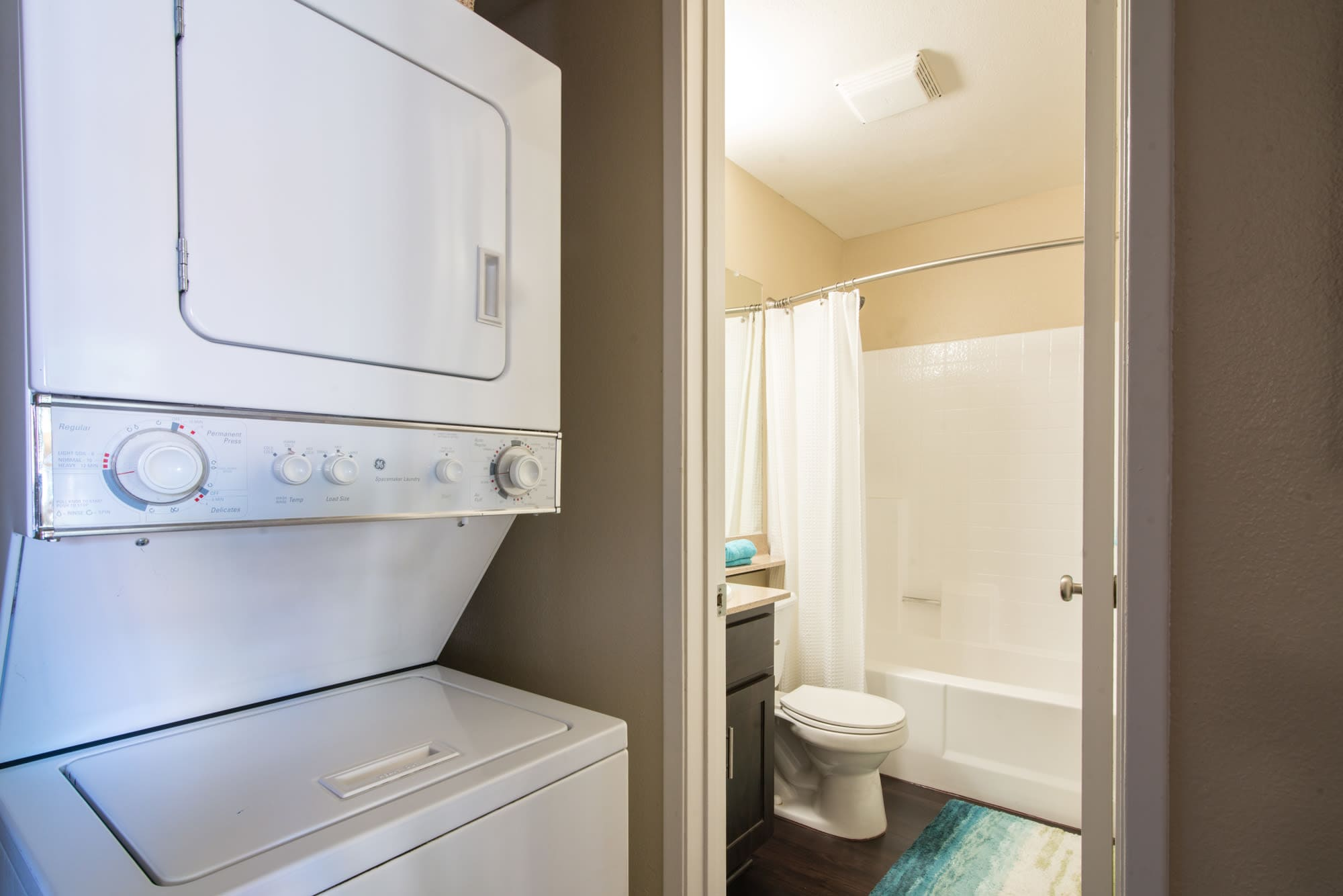 Bathroom and stackable washer and dryer at Terra Nova Villas in Chula Vista, CA