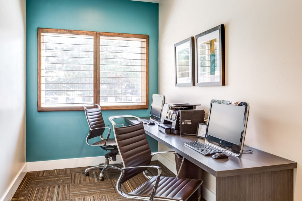 Stay connected with computers in the community business center at Royal Ridge Apartments in Midvale, Utah