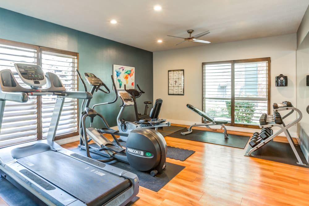 Fitness center with plenty of individual workout stations at Royal Ridge Apartments in Midvale, Utah
