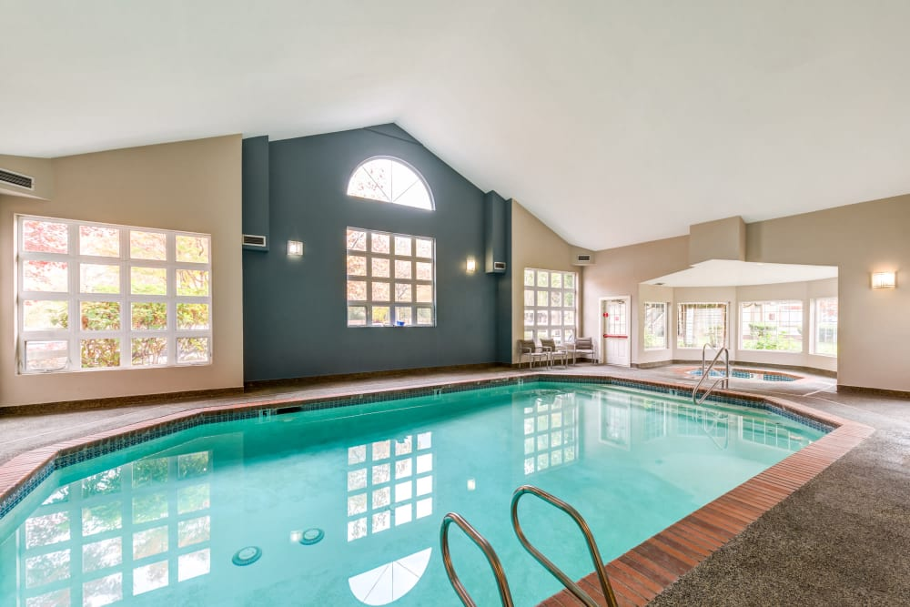 Beautiful indoor resort-style swimming pool at Olin Fields Apartments in Everett, Washington
