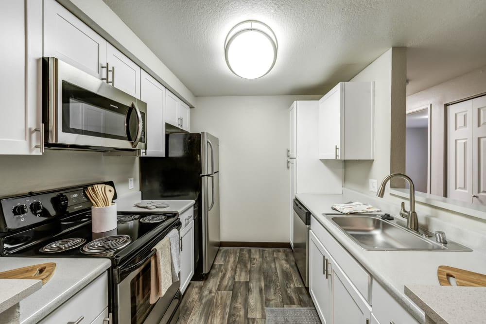 A kitchen with plenty of cabinet space at Olin Fields Apartments in Everett, Washington