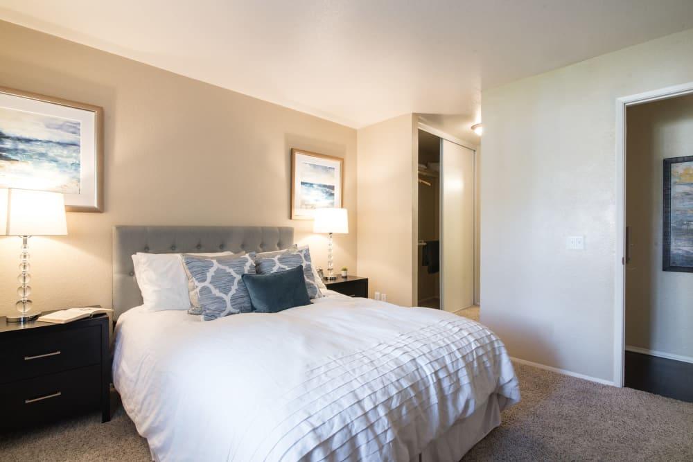 Decorated master bedroom with a large closet at Terra Nova Villas in Chula Vista, California