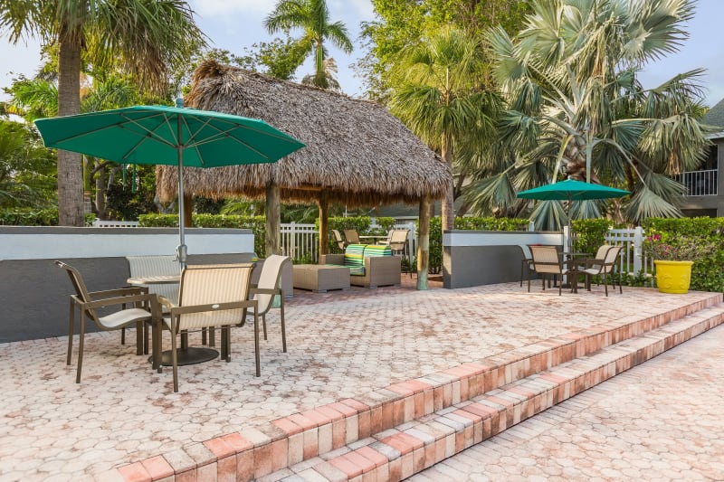 Umbrella chairs to relax in at Lago Paradiso at the Hammocks in Miami, Florida