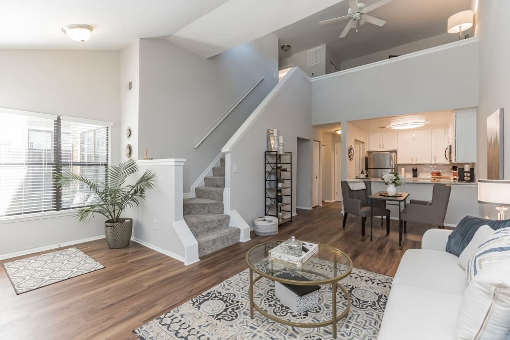 Model living room with stairs to second floor at Eagle Rock Apartments at Columbia in Columbia, Maryland
