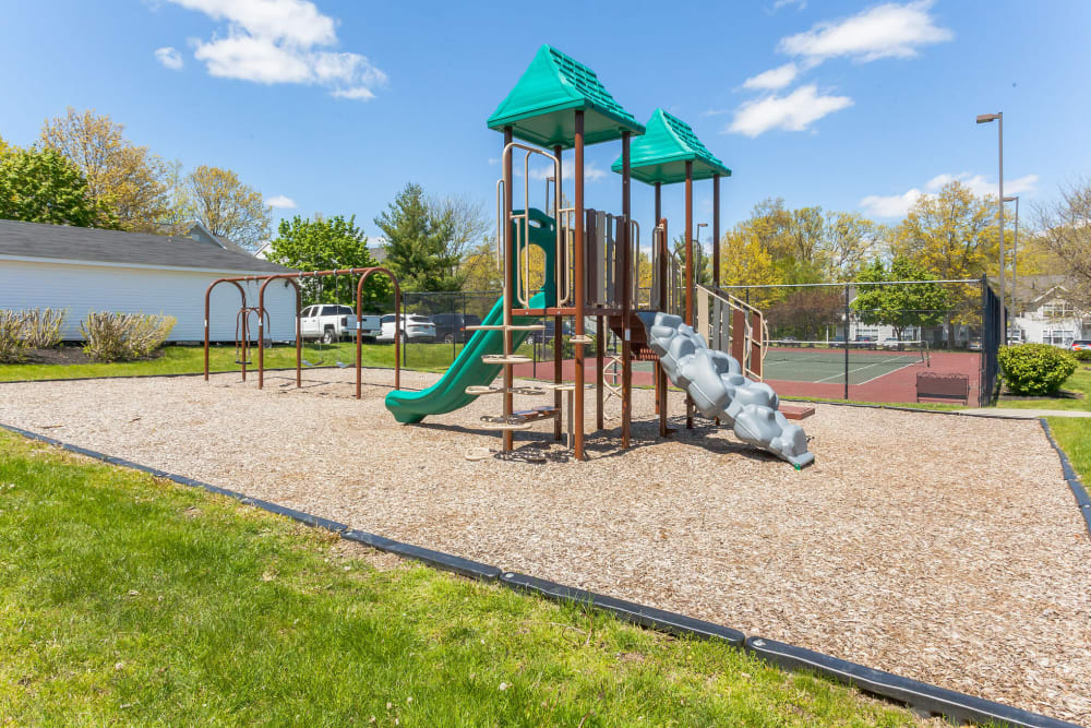 Playground and tennis courts at Vista Point Apartments in Wappingers Falls, New York