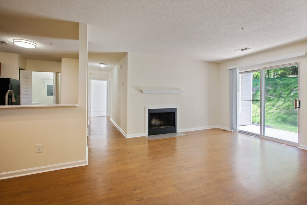 Open floor plan living room with access to outdoor patio at Vista Point Apartments in Wappingers Falls, New York