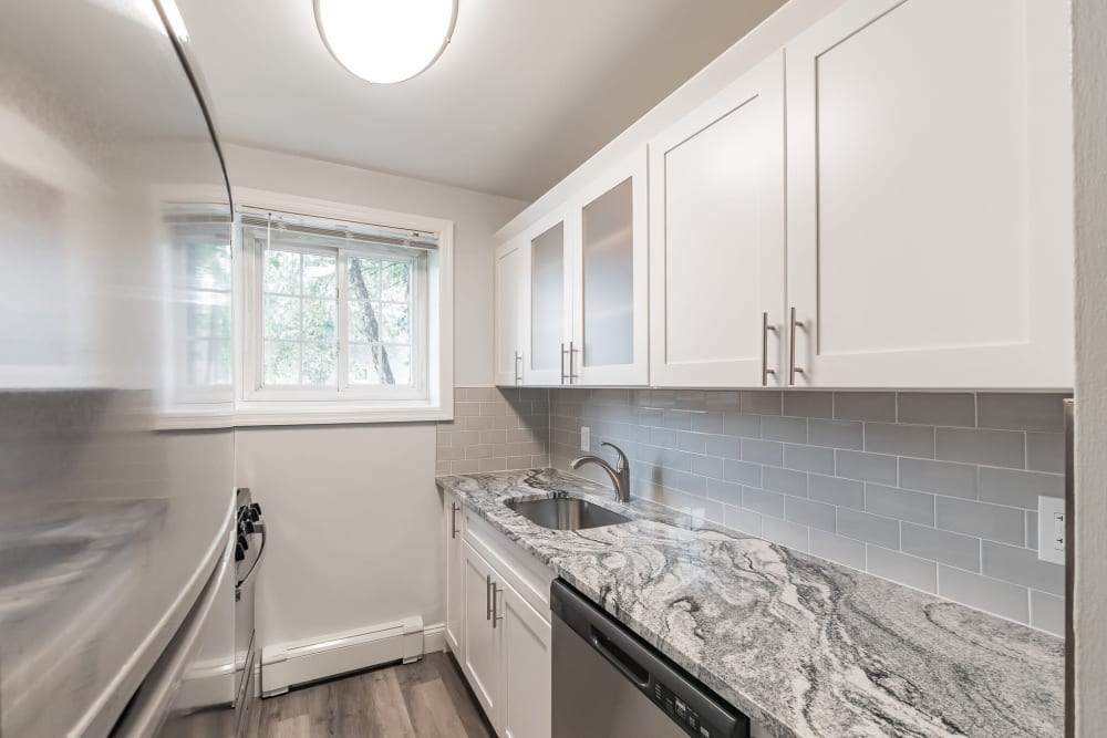 Sleek modern kitchen at Eagle Rock Apartments at Carle Place in Carle Place, New York