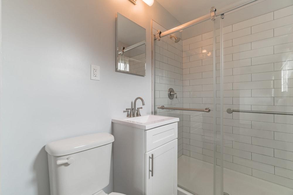 Siding door showers at Eagle Rock Apartments at Mineola in Mineola, New York