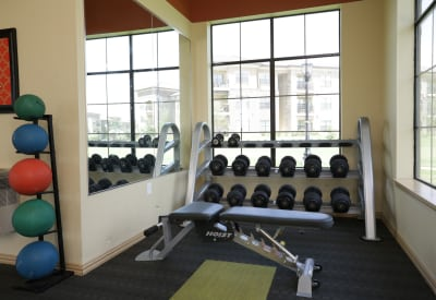 Onsite fitness center with free weights and more at Evolv in Mansfield, Texas