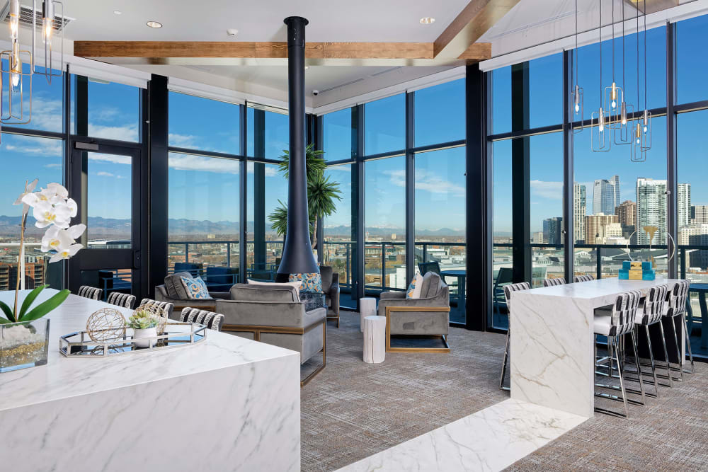 Floor to ceiling windows at Pool table and lounge at Civic Lofts in Denver, Colorado