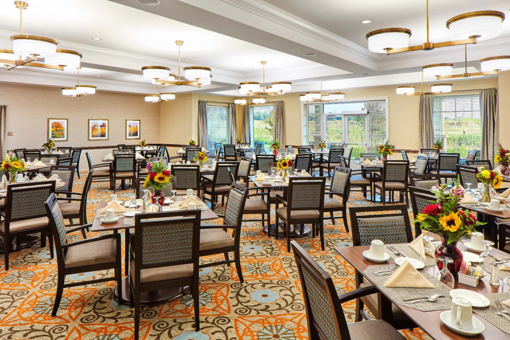 Large resident dining room at Anthology of Overland Park in Overland Park, Kansas.